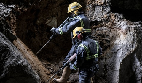 Getty Drilling Workers in Cave