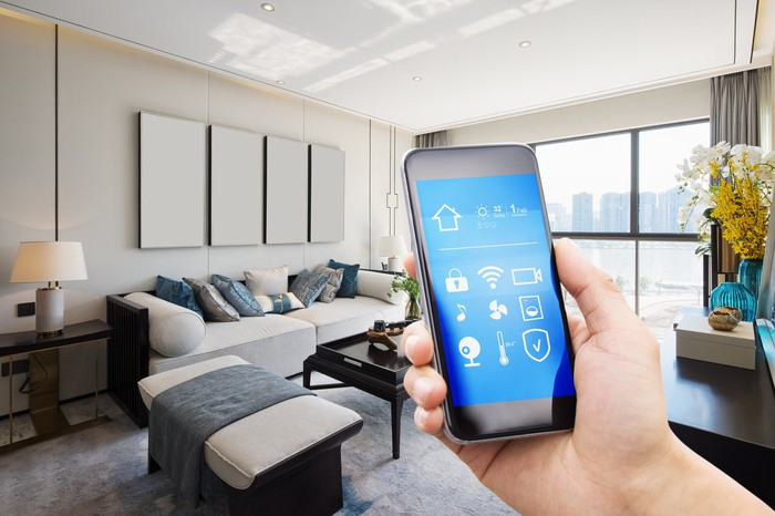 A person controlling smart-home functions with a mobile device