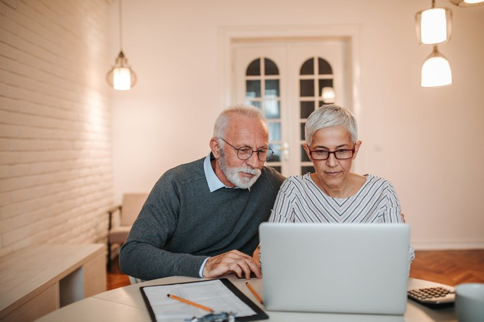 Senior man and woman using a laptop