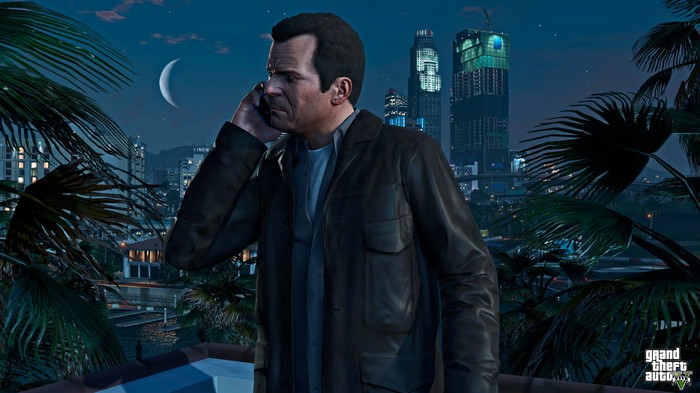 A character in Grand Theft Auto 5 on the phone with buildings in the background.