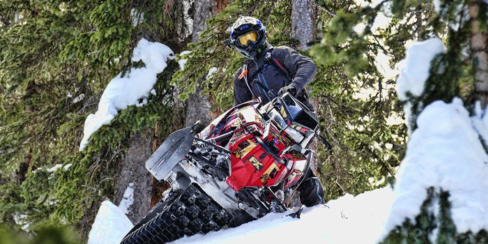 A snowmobile featuring Fox components.