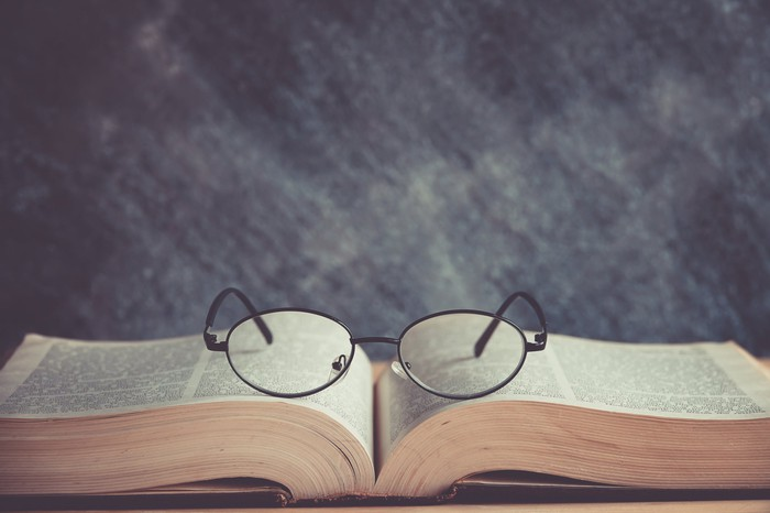 Pair of eyeglasses sitting on a book