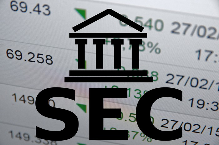 SEC logo with stock prices in the background