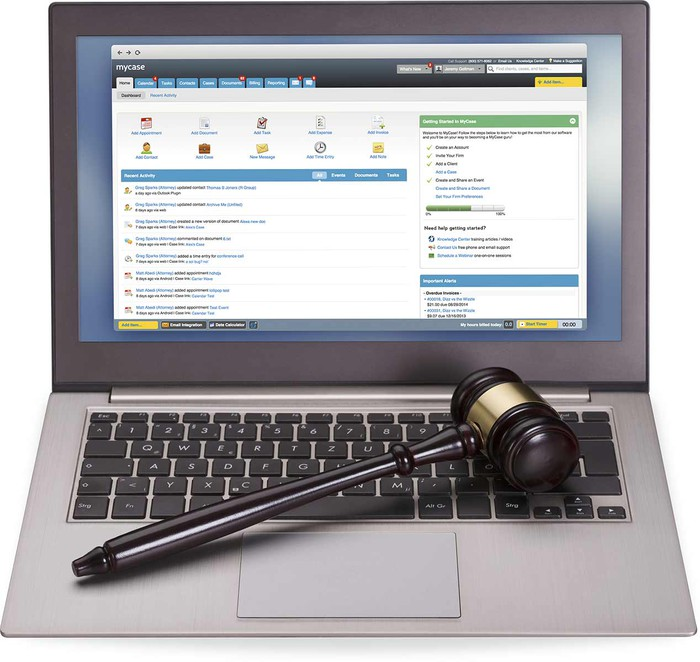 A laptop with AppFolio software running. A gavel sits on the keyboard.
