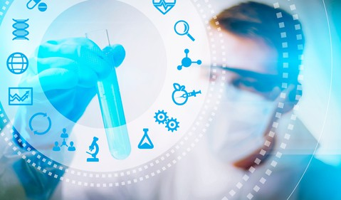 Scientist holding test tube with biotech icons