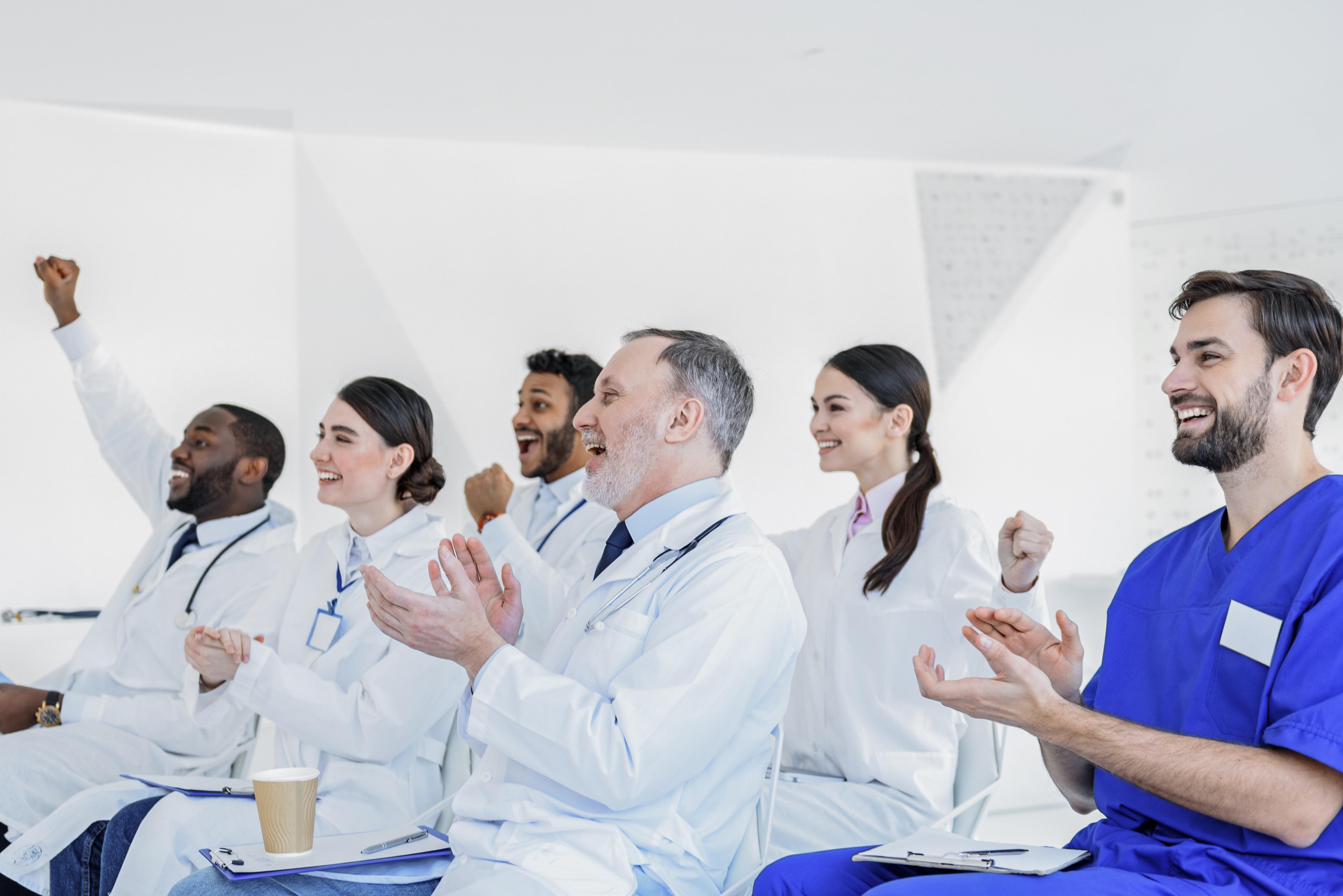 Crowd of cheering doctors.