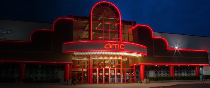 AMC theater location with awning outlined in red lights.
