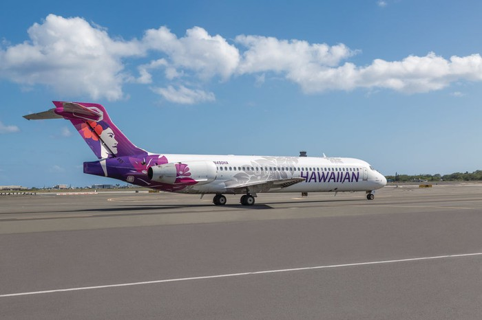 A Hawaiian Airlines jet parked on the tarmac.