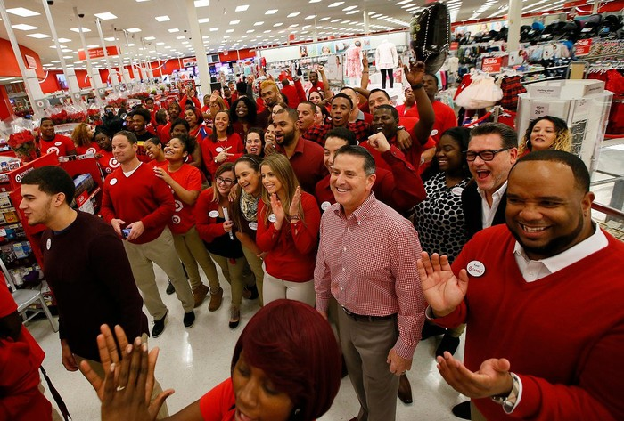 Dozens of workers at a Target store wearing uniforms.