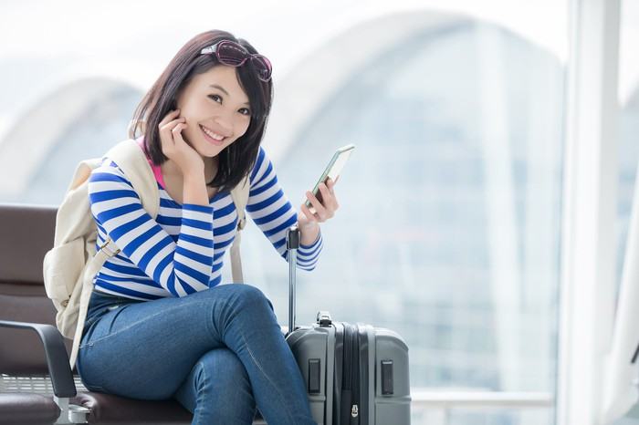 Chinese woman traveling with luggage