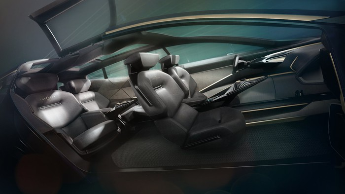 A view of the Lagonda All-Terrain Concept's interior, showing plush seating for four and a futuristic-looking dashboard.