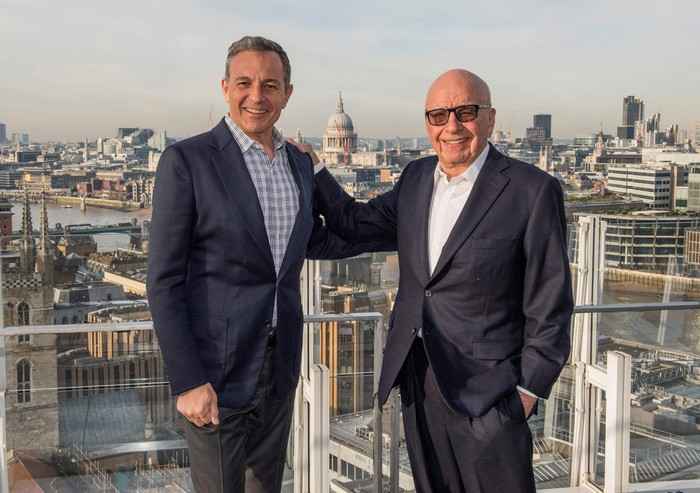 Disney CEO Bob Iger on the left and Fox chairman Rupert Murdoch on the right.