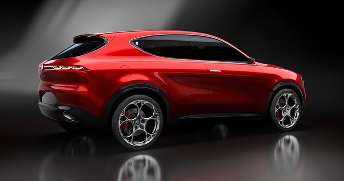A rear three-quarter view of the Alfa Romeo Tonale Concept, a sporty red crossover SUV