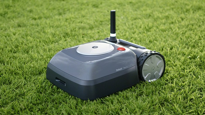 iRobot's new Terra Lawn mower on top of green grass
