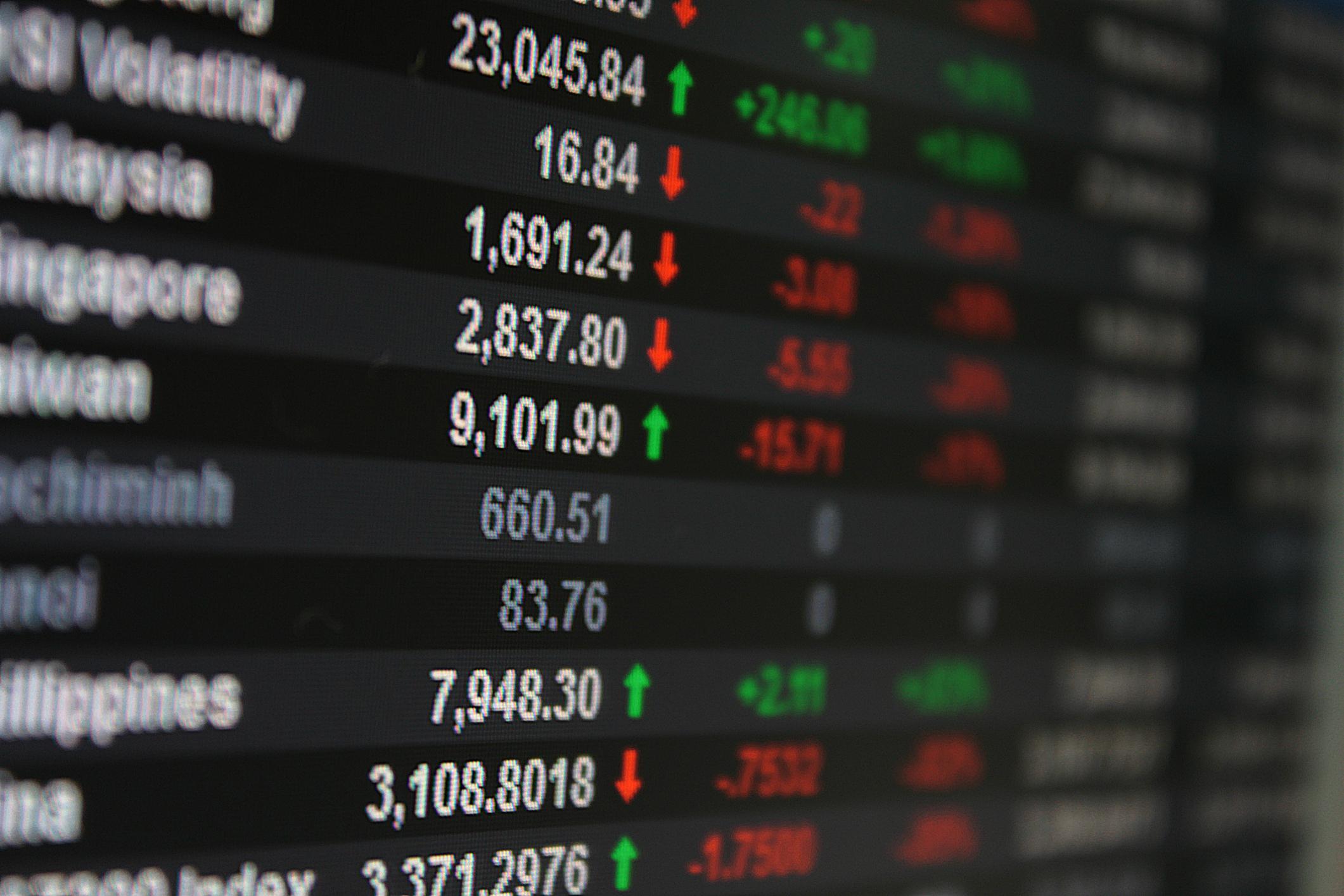 Digital display showing various Asian stock market index prices.