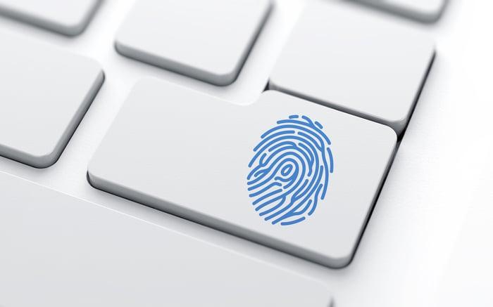 A blue fingerprint on a keyboard key