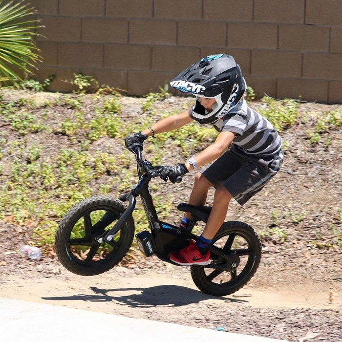 Child riding StaCyc electric bike