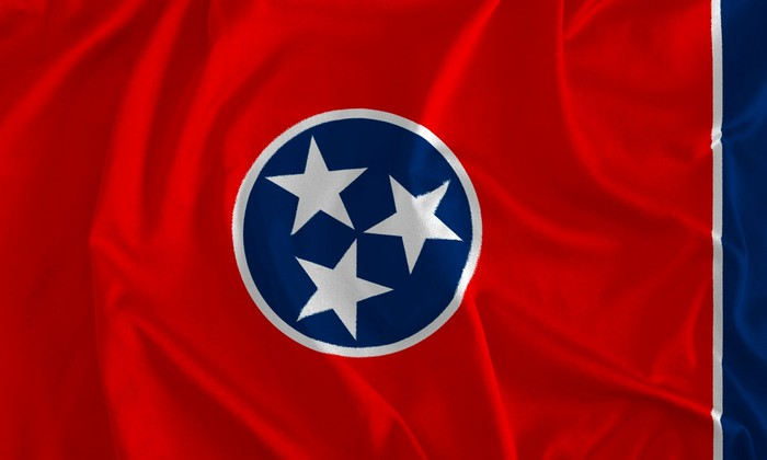 Flag with red background and centered circle with blue background and three white stars.