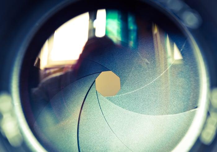 A close-up of a camera lens aperture.