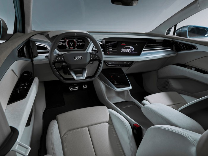 A view of the front seats and dashboard of the Audi e-tron Q4 Concept, showing high-quality materials and sleek design.