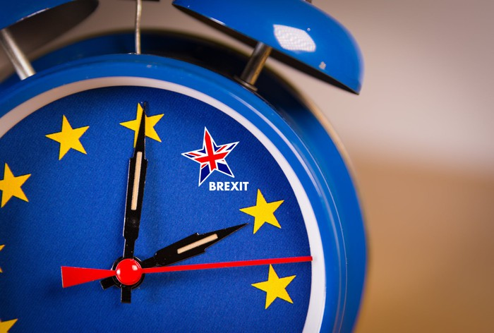 "A clock in the colors of the European flag with the minute hand moving toward a star in the colors of the Union Jack, which is labeled ""Brexit"""