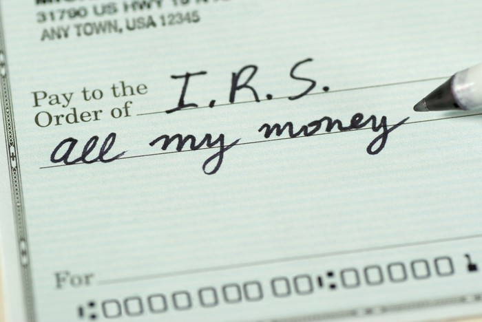 "Person writing check to the IRS for ""all my money"""