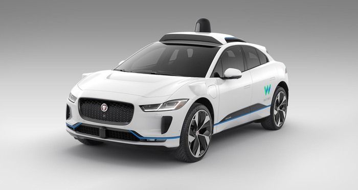 A Jaguar I-Pace car with Waymo branding.