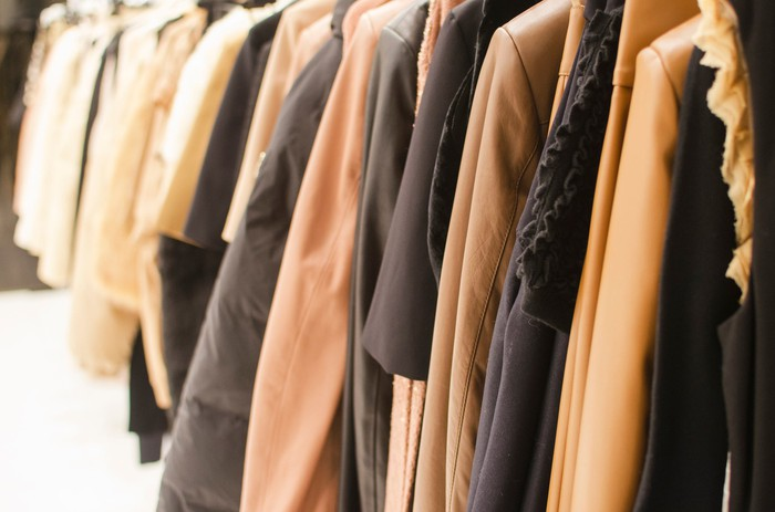 A rack of coats at a retail store.