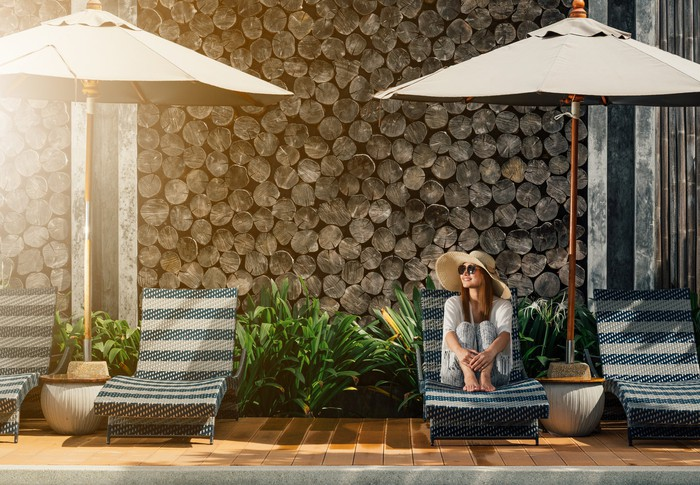 A woman lounging by a hotel pool
