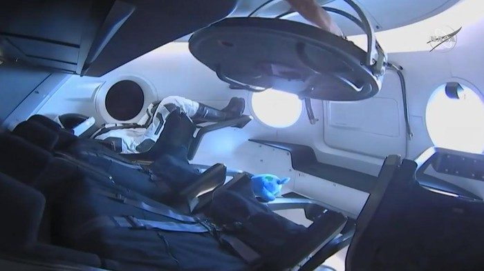 Inside of Crew Dragon capsule viewed through hatch of ISS