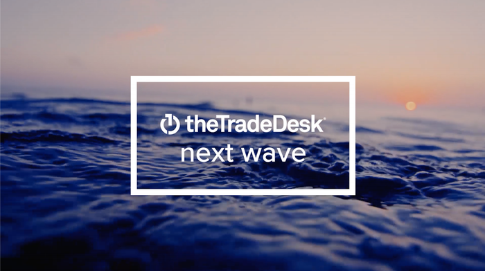 The Trade Desk logo with the words Next Wave below the company name.