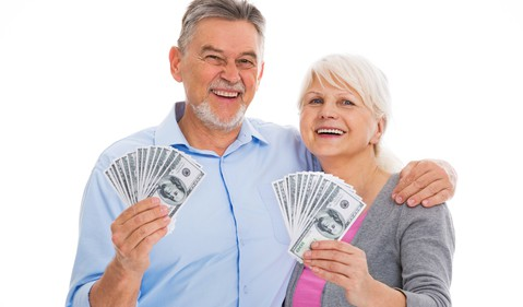 senior couple with money in their hands