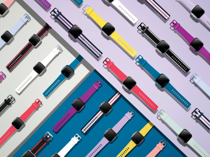 Fitbit Versa Lite Edition devices in various colors