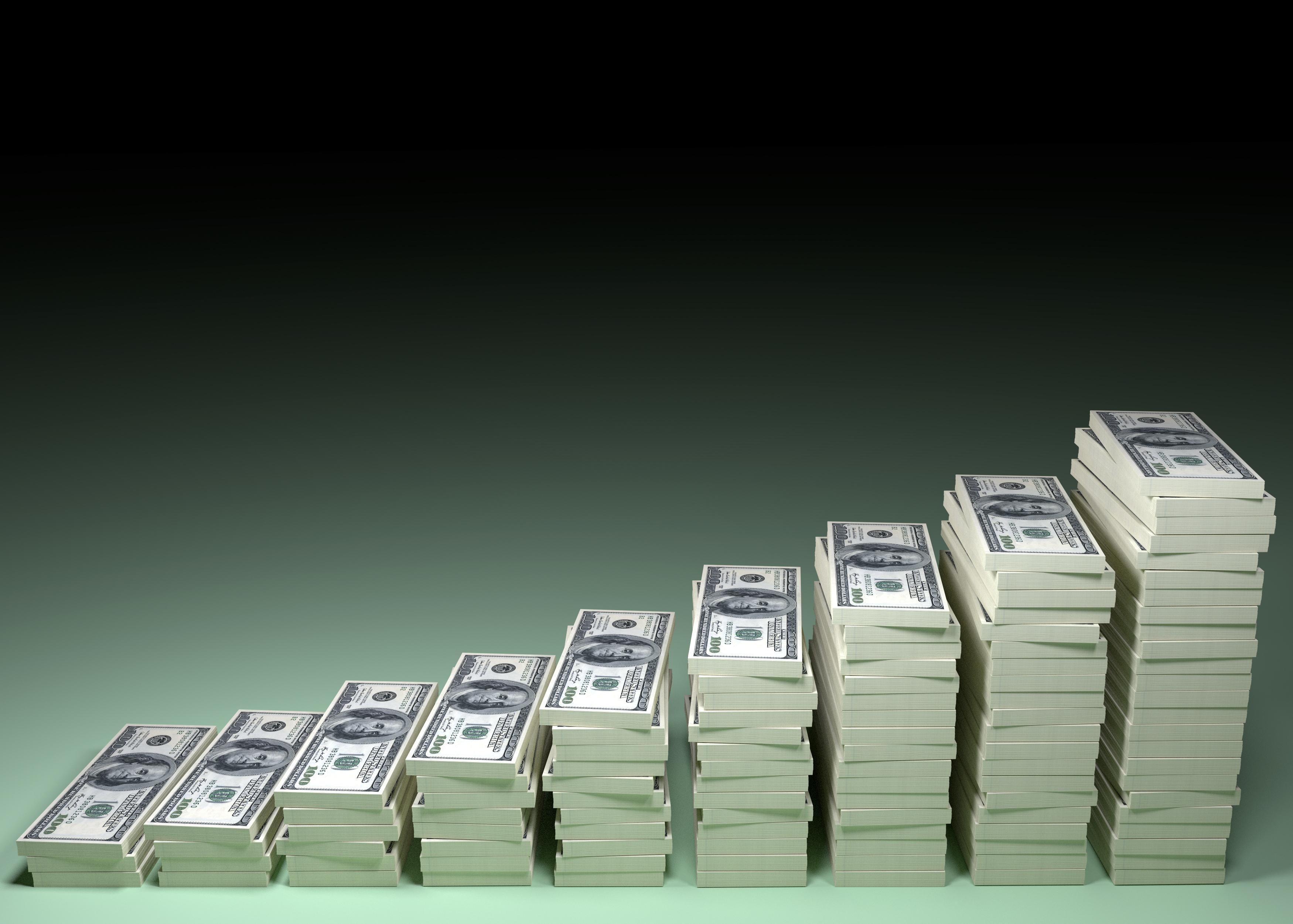 Money stacks arranged from shortest to tallest.