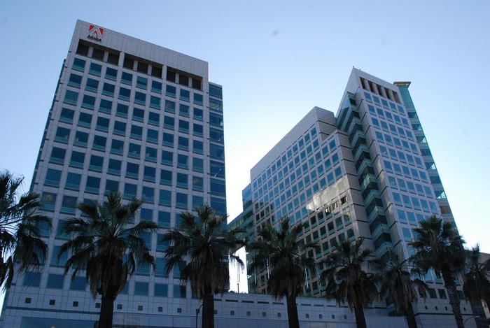 A multistory building with the Adobe logo at the top.