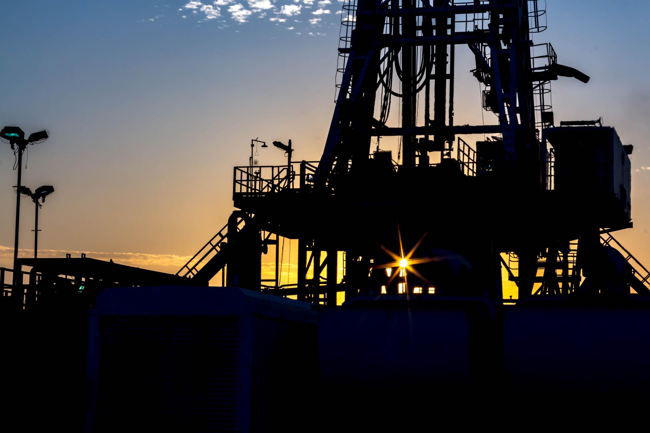 A drilling rig at dusk.