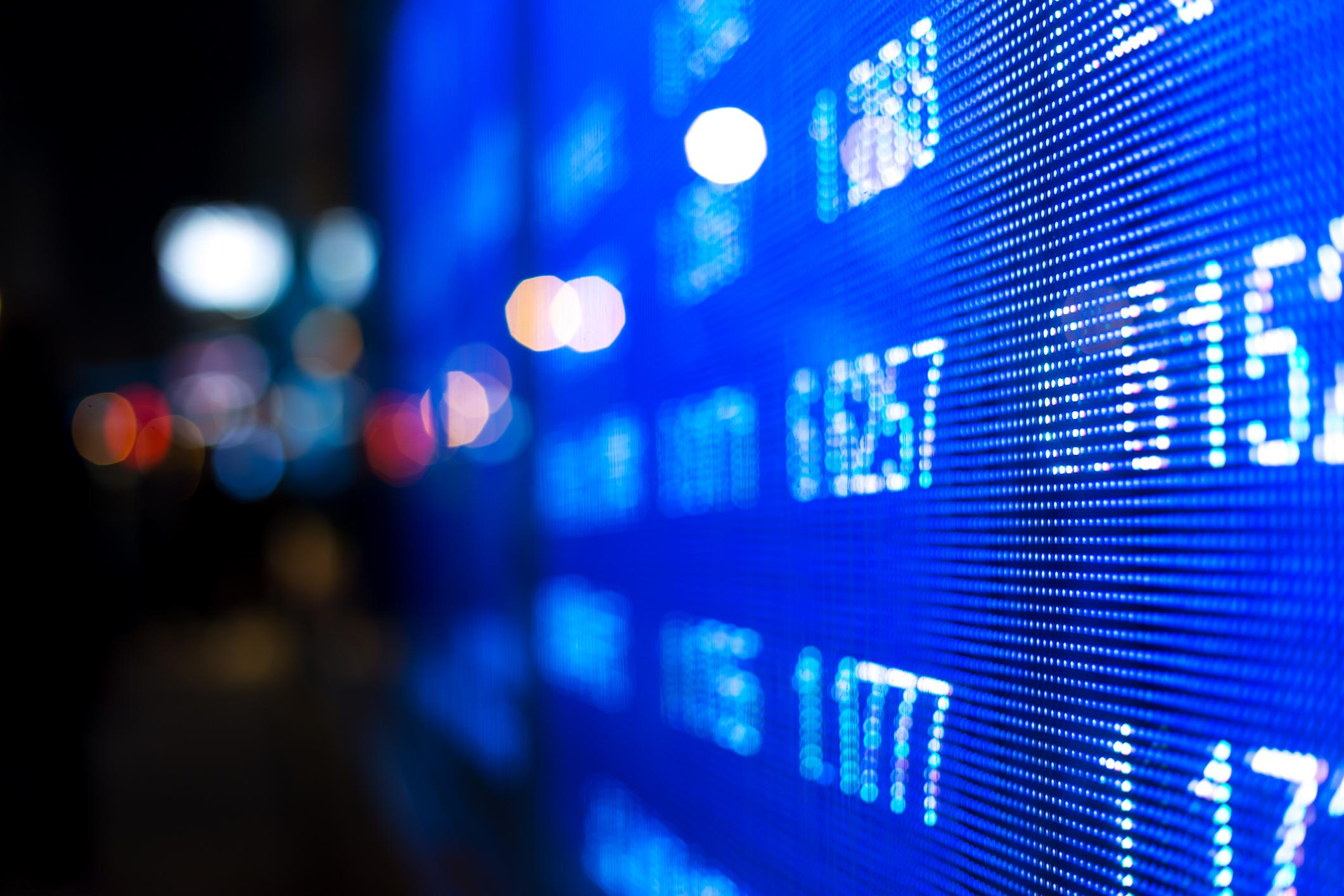 Stock market data on a digital screen.