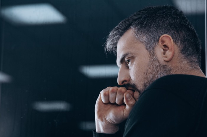 Man resting his chin on his fist as if deep in thought