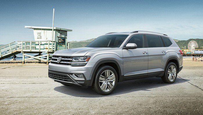 A 2019 Volkswagen Atlas, a U.S.-made 7-passenger SUV, parked near a beach.