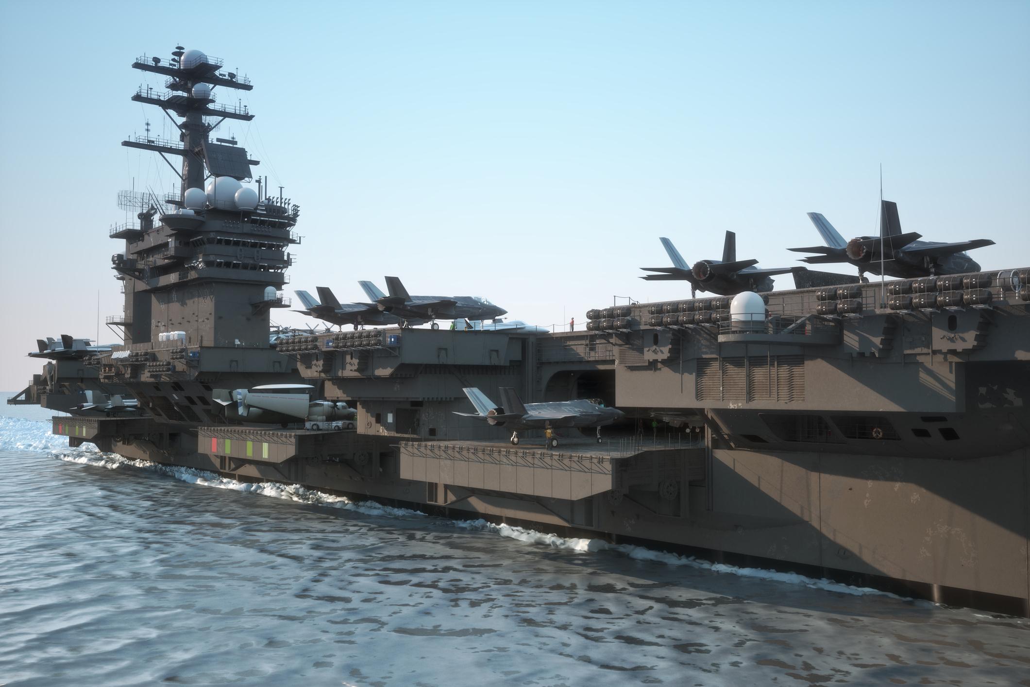 An aircraft carrier in open water.