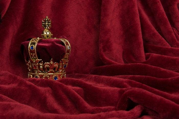 A crown sitting on a purple drape