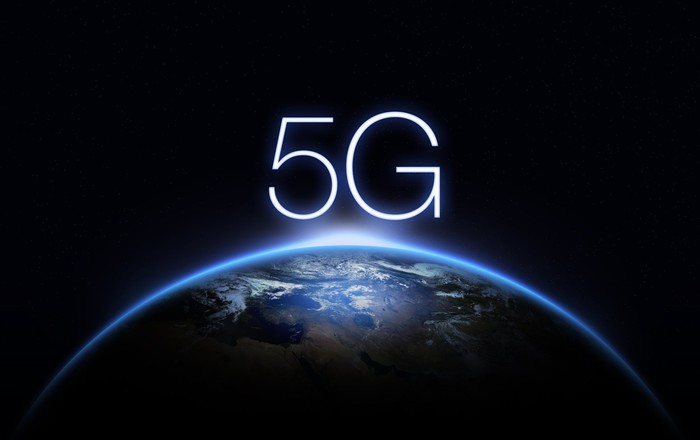 """Part of the Earth seen from space at sunrise, with """"5G"""" above the image"""