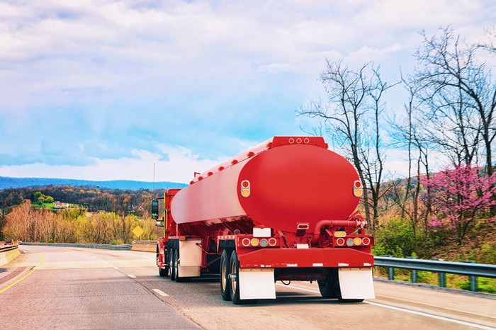 A truck carrying diesel fuel on a highway.