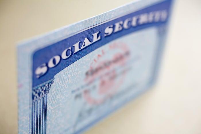 A Social Security card coming into focus.