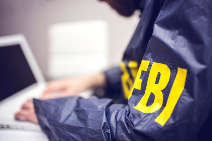 FBI agent at a computer