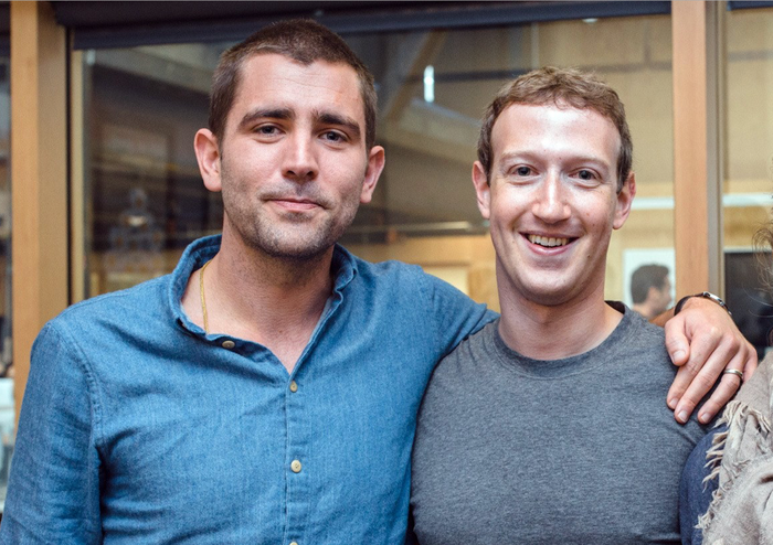 Chris Cox standing with his arm around Mark Zuckerberg