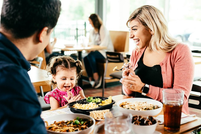 A family eating at Noodles & Company.