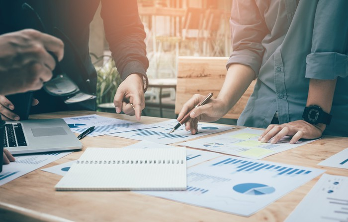 Investors review a company's balance sheet.