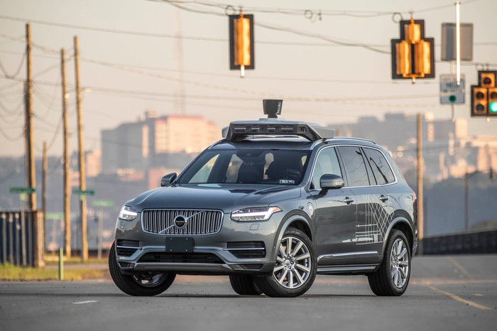 A Volvo SUV with Uber's autonomous vehicle technology on it.