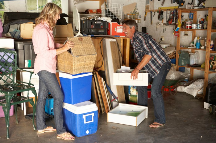 Couple in cluttered garage.